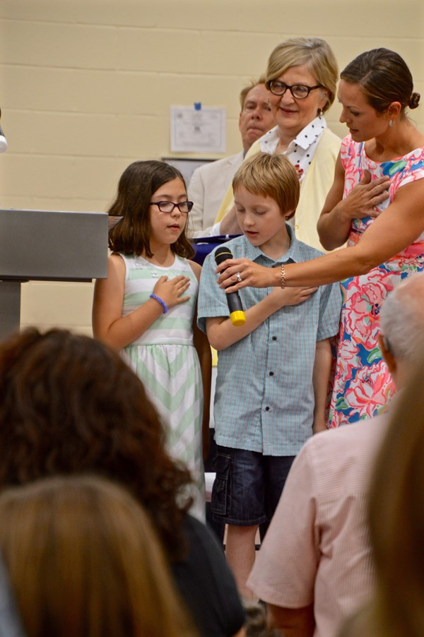 Grant students Zoe Pace and Logan Foster lead the Pledge of Allegiance.
