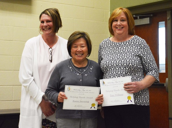 PTA Council President Kim Walcheck with Helping Hands winners Karen Stovering (center) and Pam Williams.