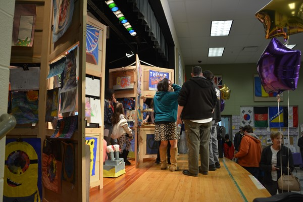 Artwork filled the stage and was displayed on wooden easels with display shelves designed and built by a Garfield parent.