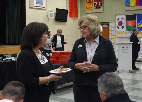 Retirees Sharon Harwat and Gladys Favre swap stories.