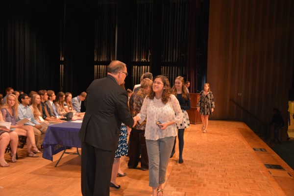 Junior Veronica Lee receives her award from the Superintendent.