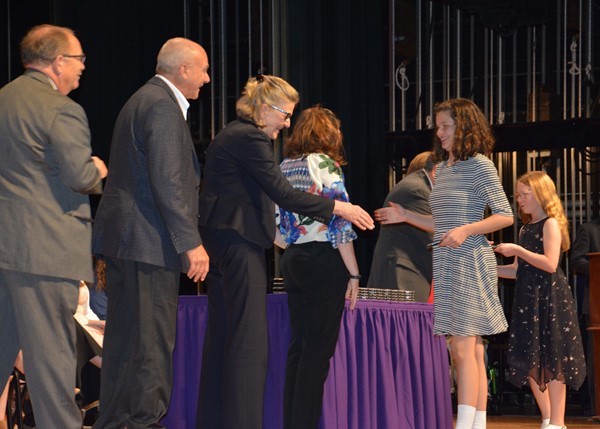 Receiving their medals from Board members and Supt. Patterson