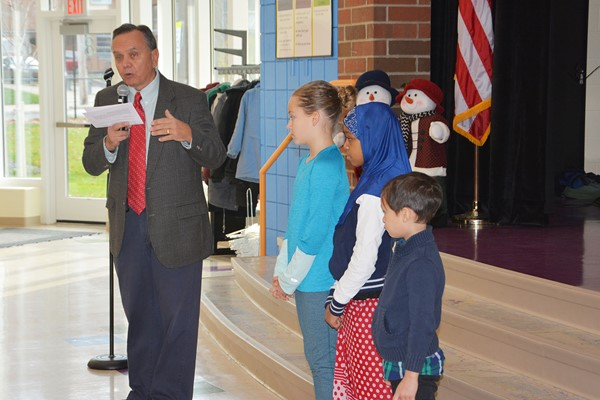 Board Member Ed Favre and students who led the Pledge of Allegiance.