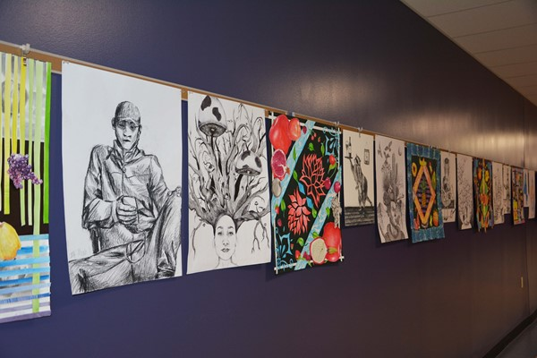 Student artwork on the wall greeted visitors to the new hallways.