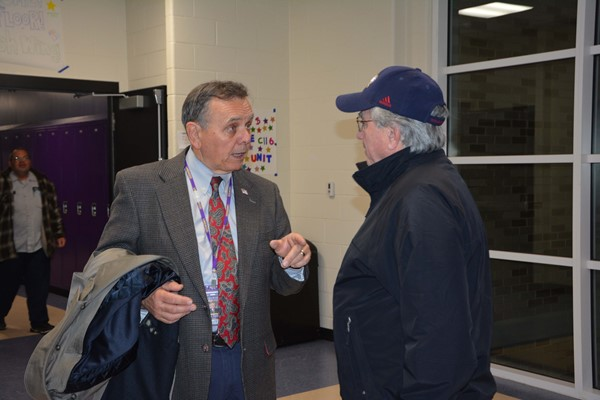 Board member Ed Favre chats with a community member.