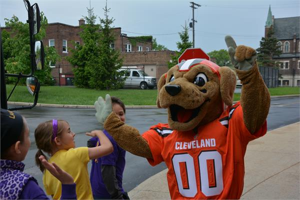 Chomps was there to surprise and greet the students as they arrived.