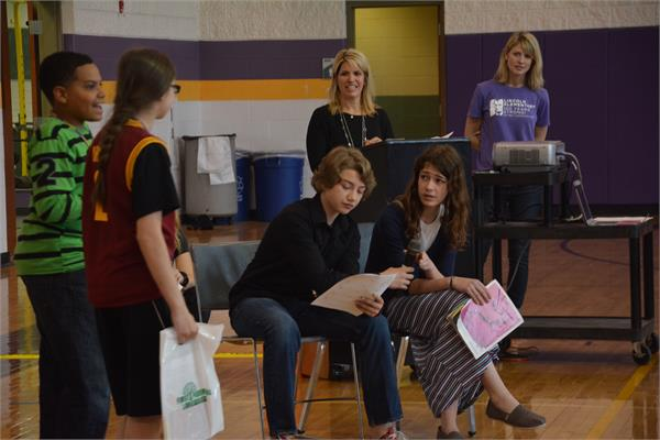 A skit by the Garfield Drama Club helped students understand how the program will work.