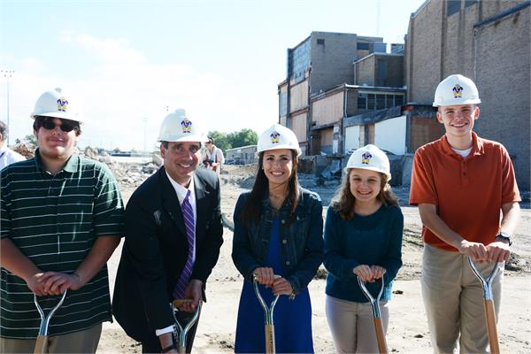 Students (from left) Jonathan Thompson, Angela Vogli, Erin Black and Zach Howe join Principal Keith Ahearn for a photo after the groundbreaking.