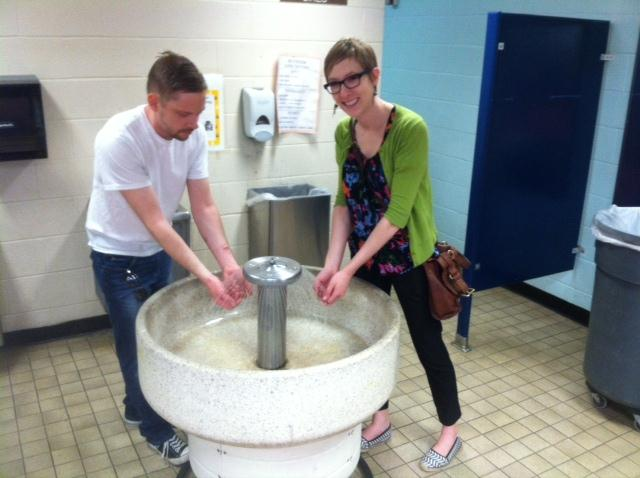 Russ Turk and Rachel Yencha relive some memories of washing their hands in the big, round sink.