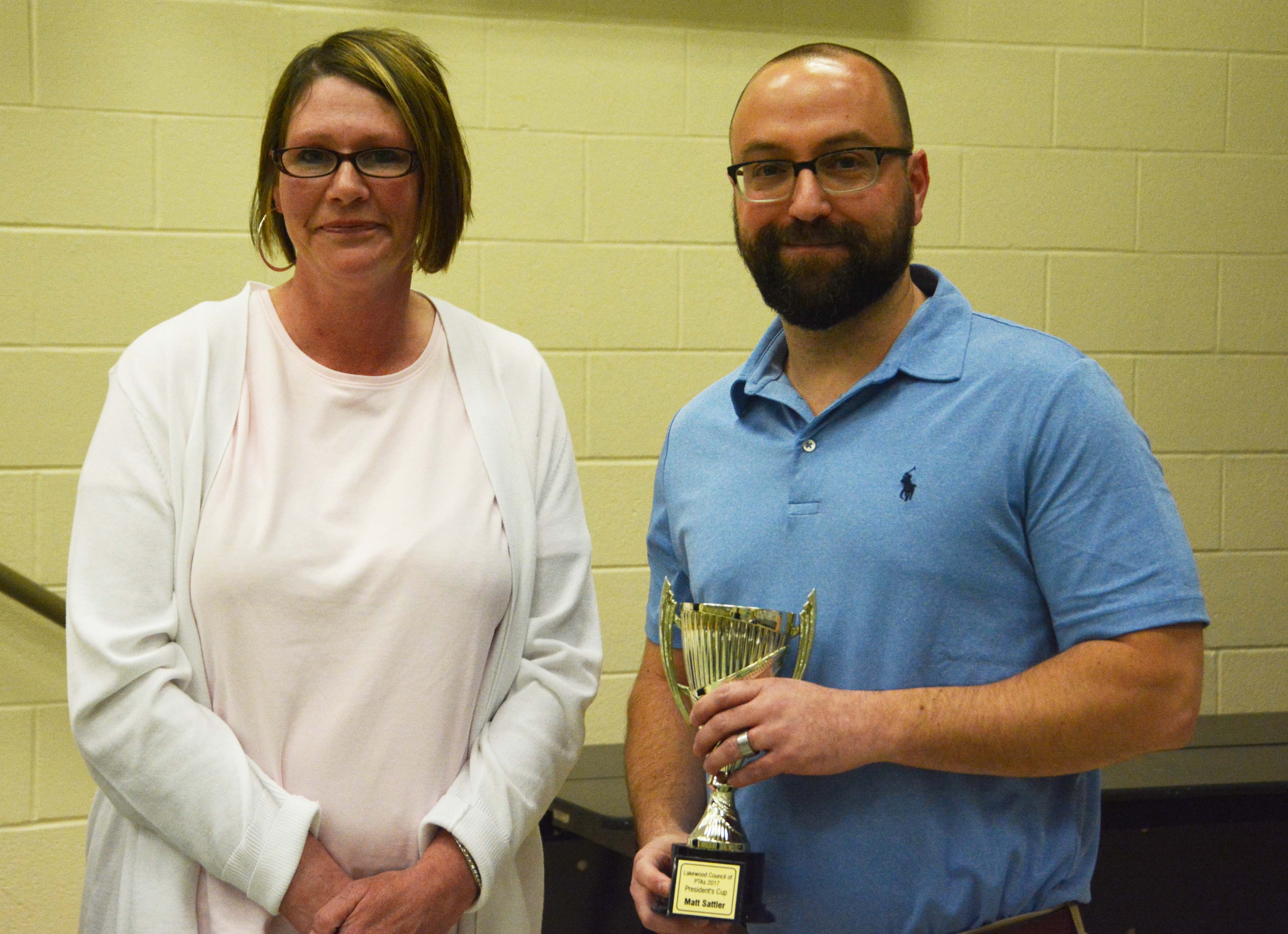 Council President Kim Walcheck with President's Cup winner Matt Sattler of Grant PTA.