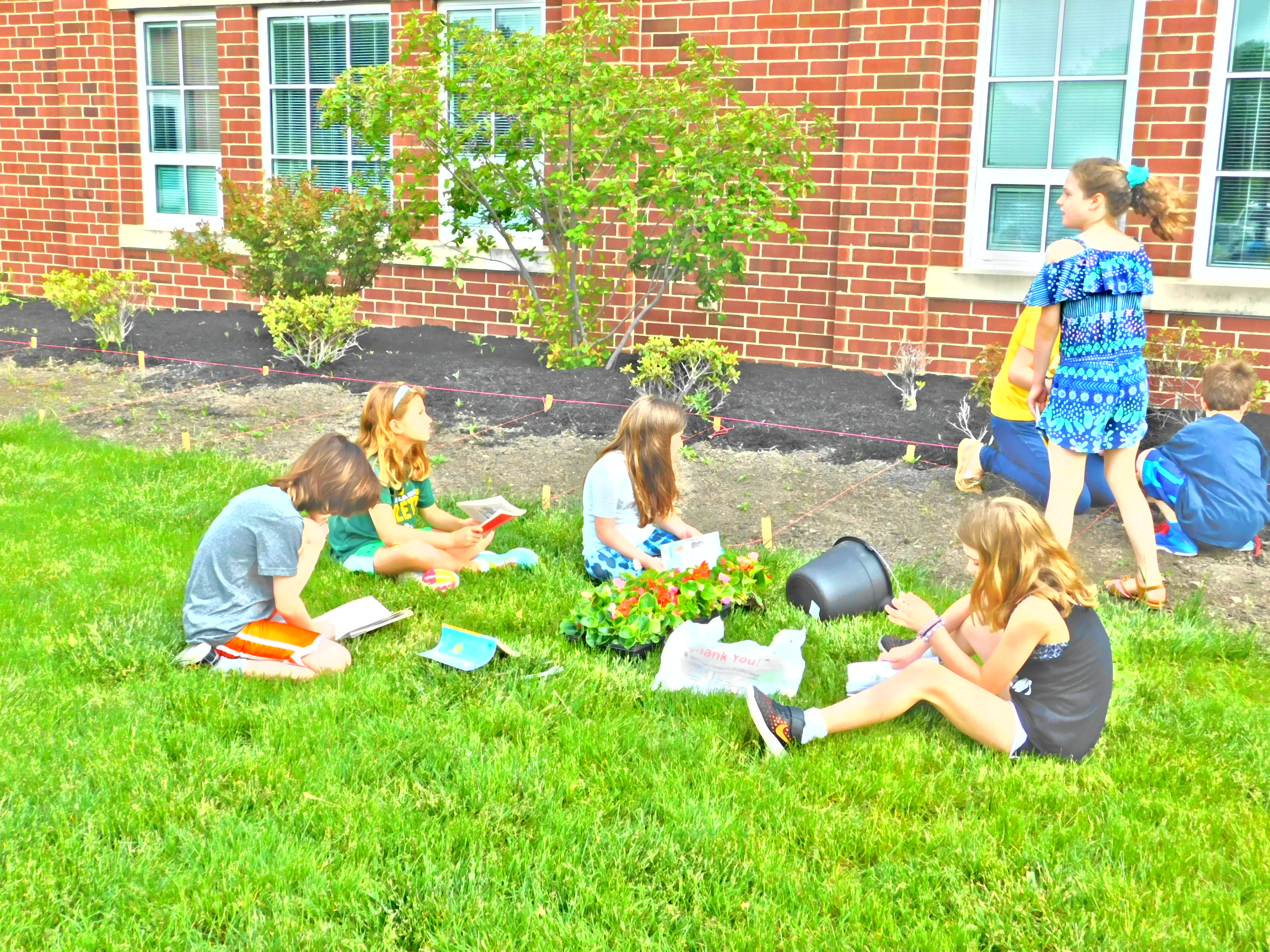 Reading and Planting 2nd Grade!